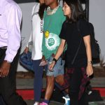 Pharrell  Williams wears pink Timberland boots and Chanel Fannypack