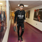 Kelly Oubre Jr.  In  A Givenchy 'I Feel Love' Sweater