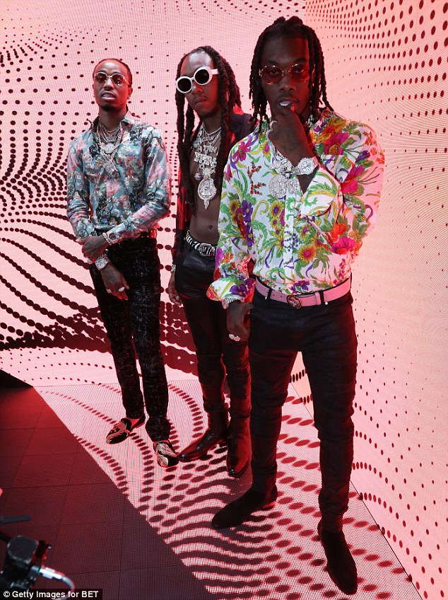 b6ba04e31376 The hiphop group Migos won best group BET Award . They are all rocking  floral shirts styled with black leather pants.