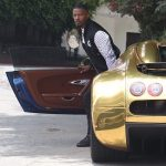 Jamie Foxx was spotted exiting a gold Bugatti