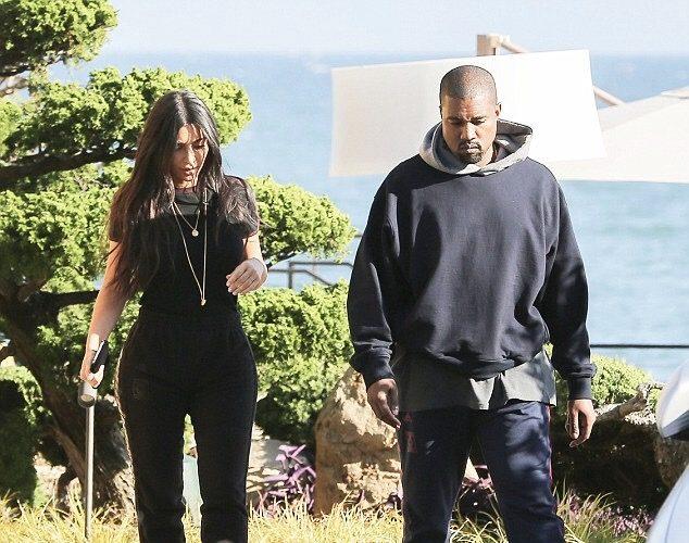 Kanye-West-Kim-Kardashian-Fear-of-God-hoodie-Adidas-Yeezy-Calabasas-sweatpants-Adidas-sneakers-3