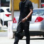 Travis Scott  In Balenciaga  &  Nike Air  Jordan 4 Sneakers