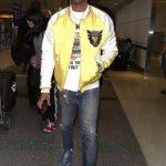 Pharrell In Human Made Jacket & Adidas Hu NMD Sneakers