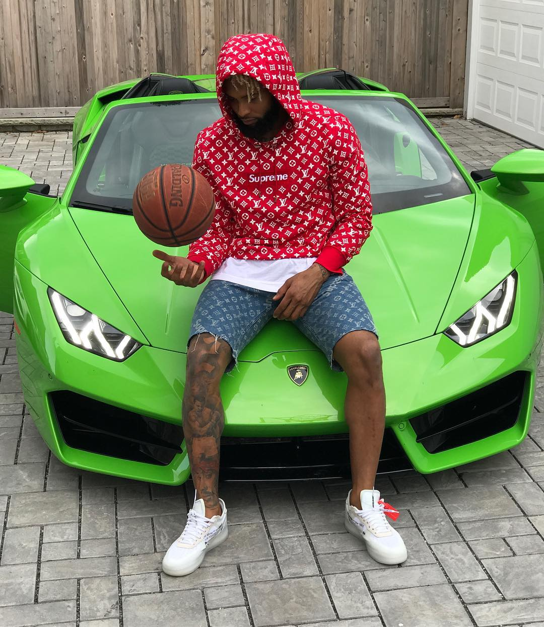 odell-beckham-jr-in-louis-vuitton-x-supreme-on-lamborghini